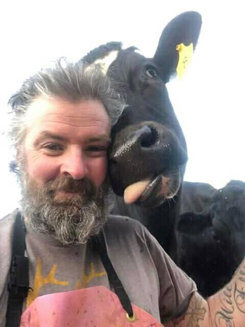 Pictured: Unnamed farmer and cow showing thanks for donations.
